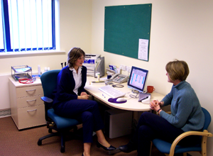 Photograph of a doctor and a patient in a consulting room